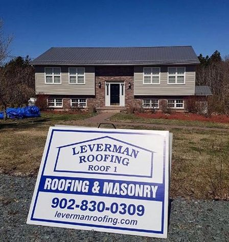 house new roofing and sign